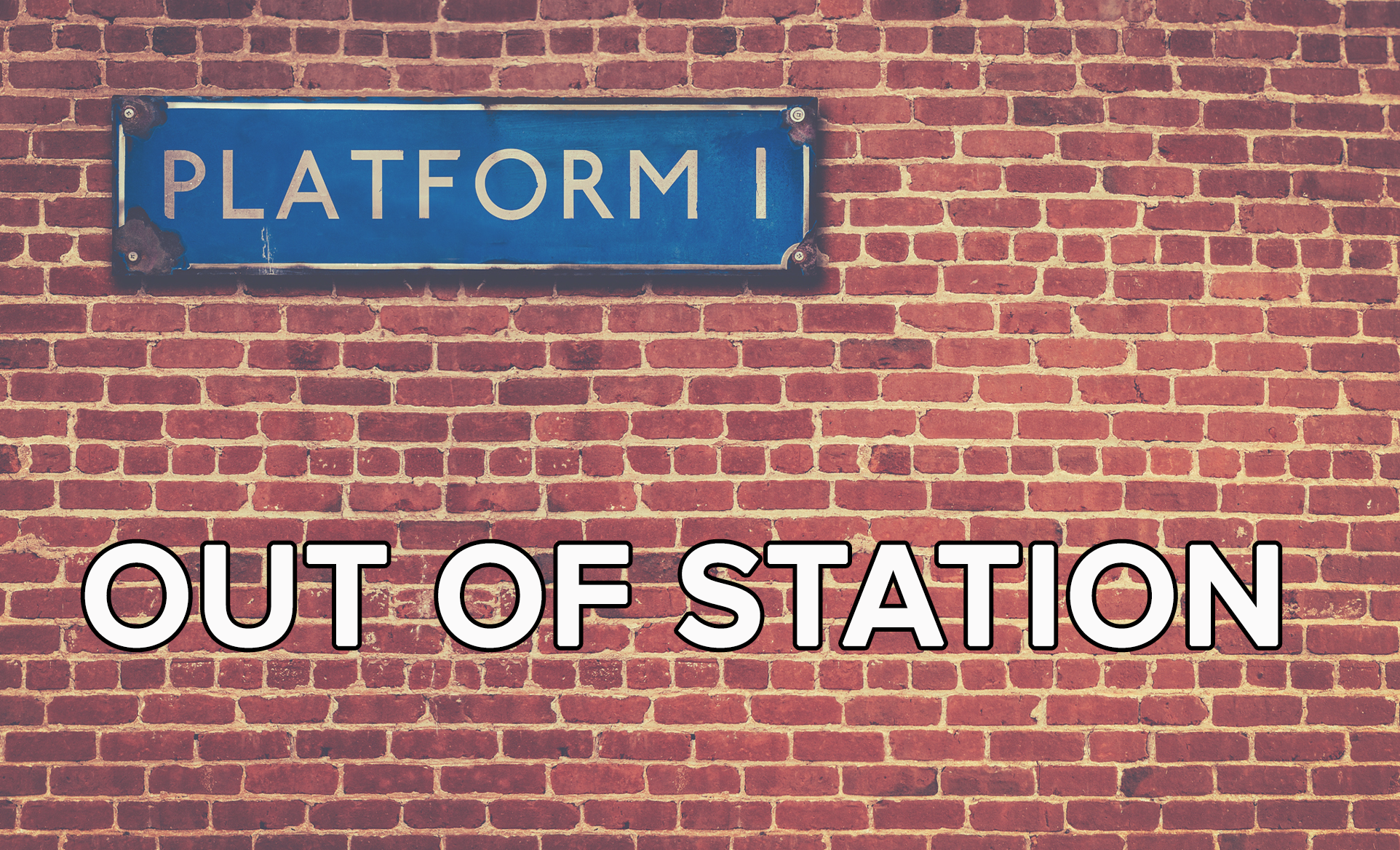 A brick wall of a train station with a sign that says platform 1