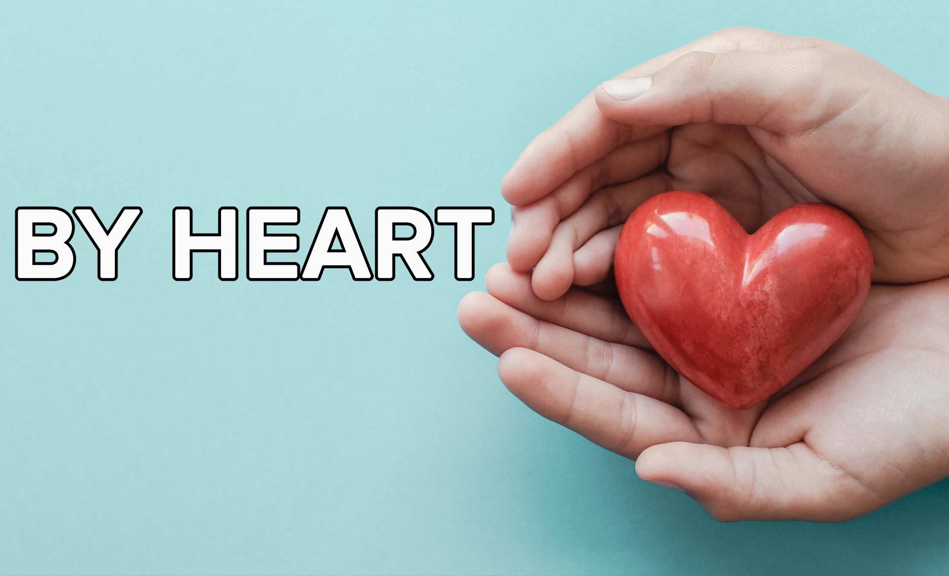 A person holding a heart-shaped object