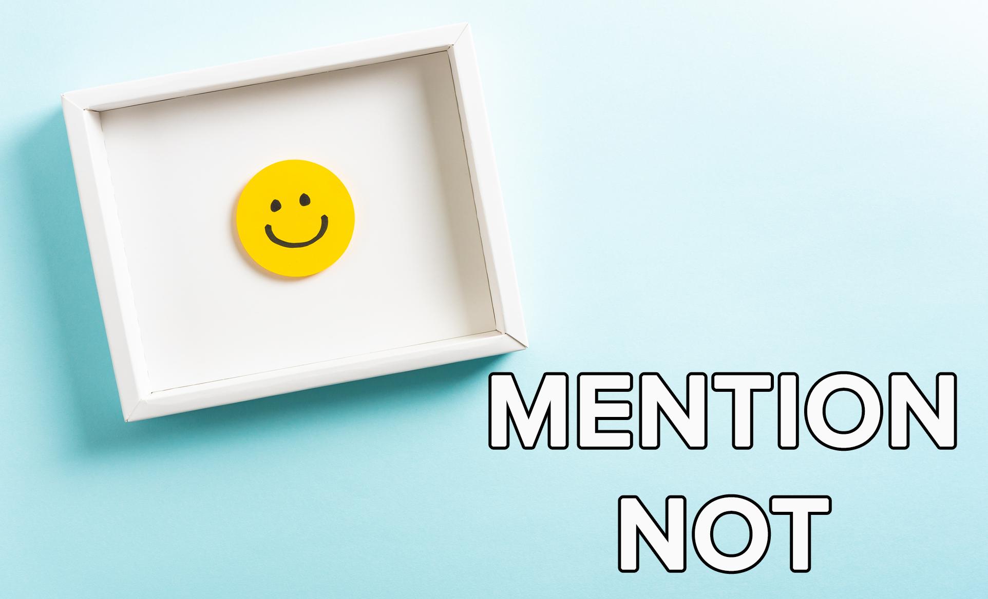 A photo-frame has a smile emoji inside it