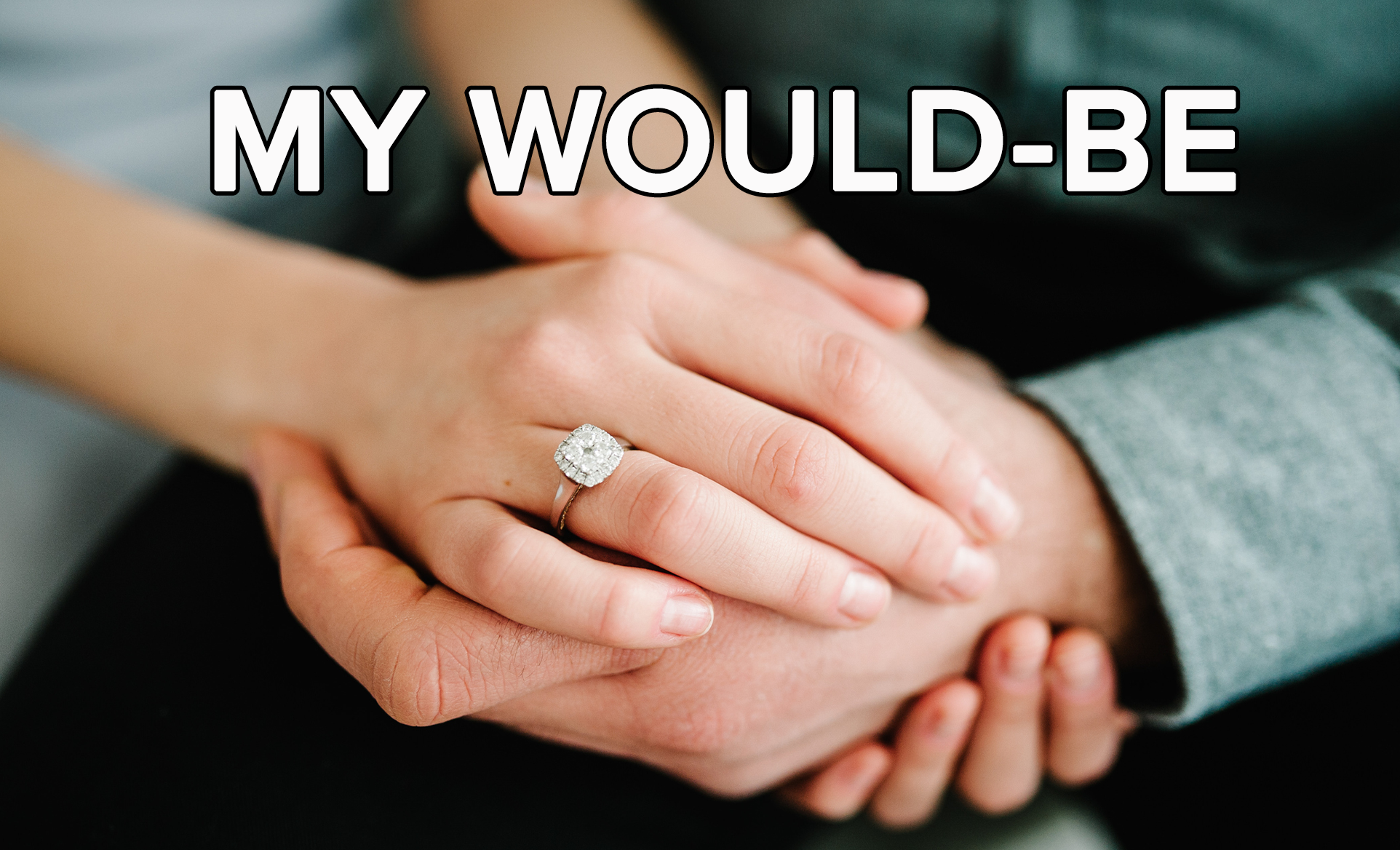 A newly engaged couple hold hands, flaunting the diamond ring adorning the woman's finger