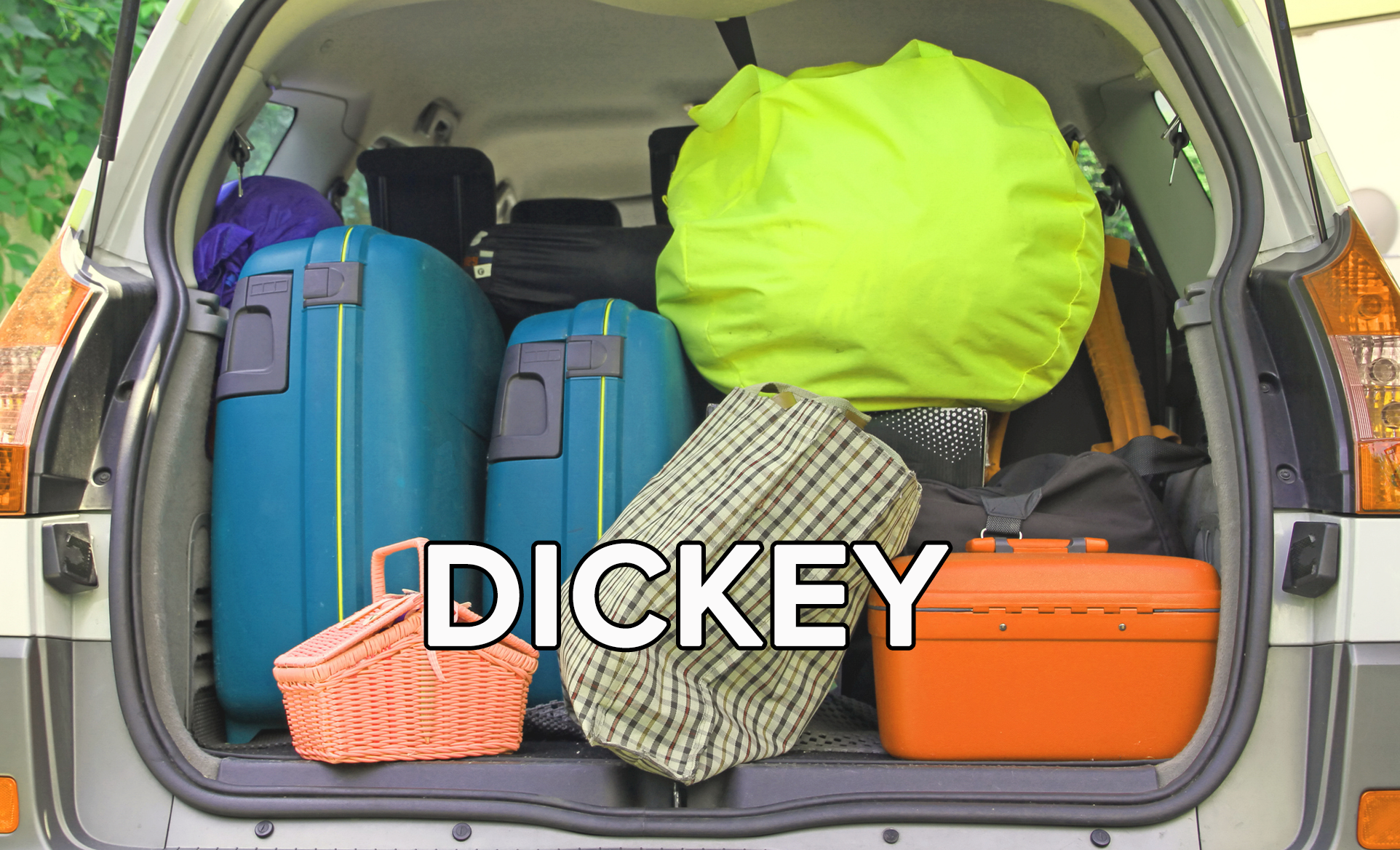 The trunk of a car is filled to the brim with luggage