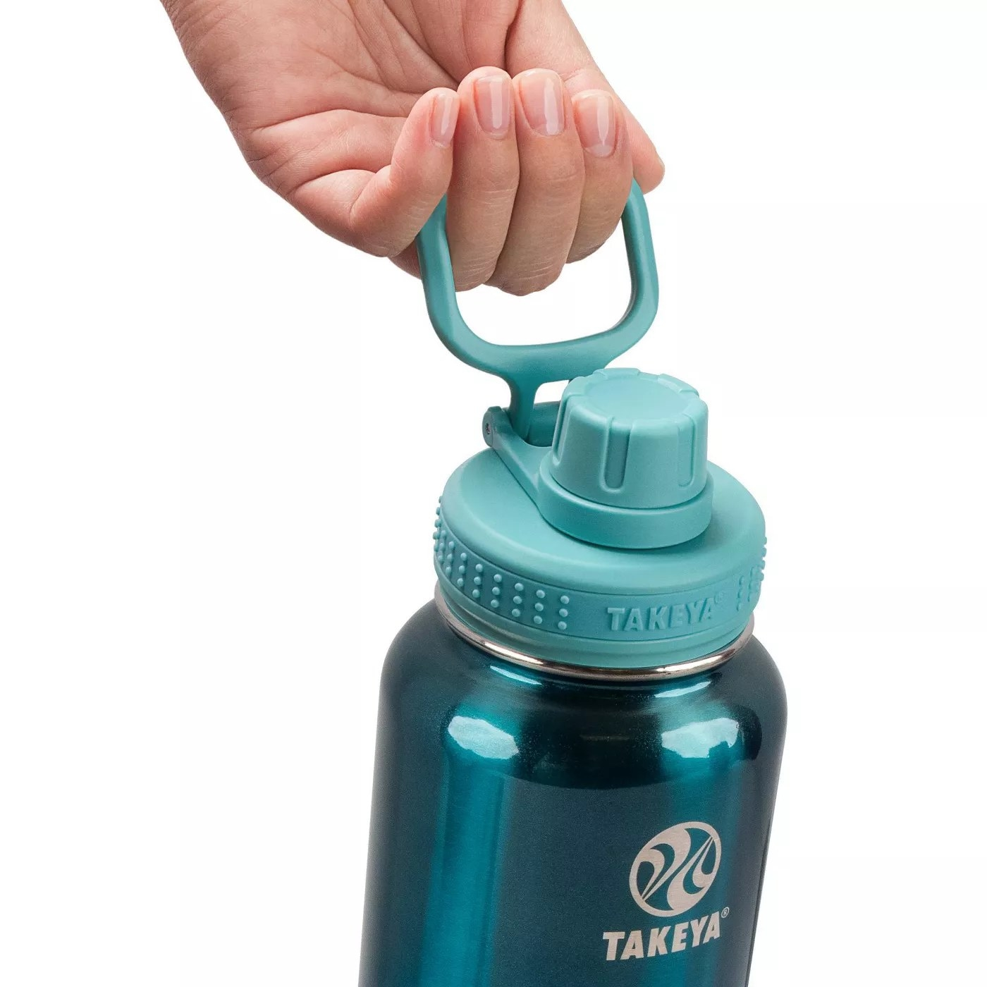 A hand holding the shiny jade water bottle by its handle