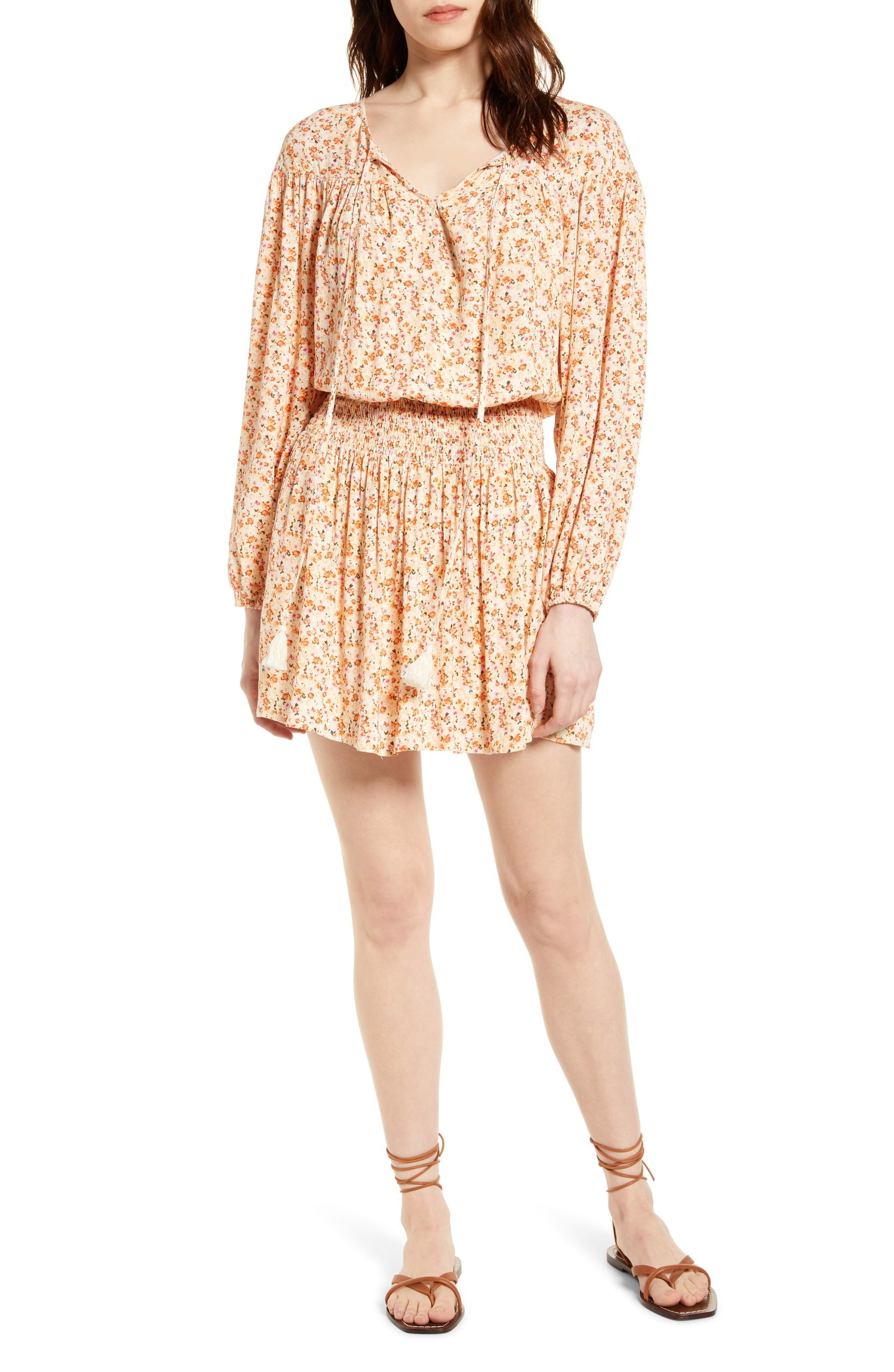 A model wearing the yellowish floral smocked waist dress — it comes down to their mid thigh, a little before the knees