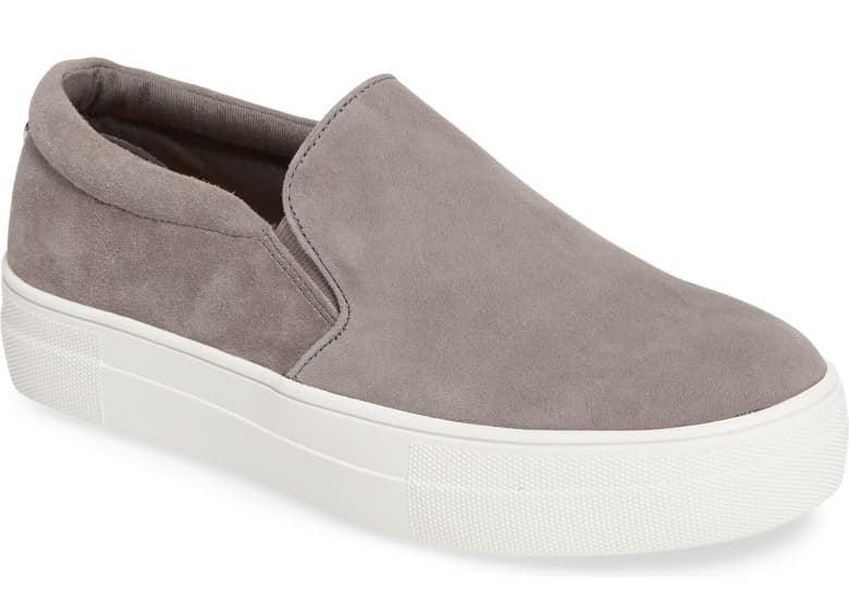 The light gray slip-on shoes