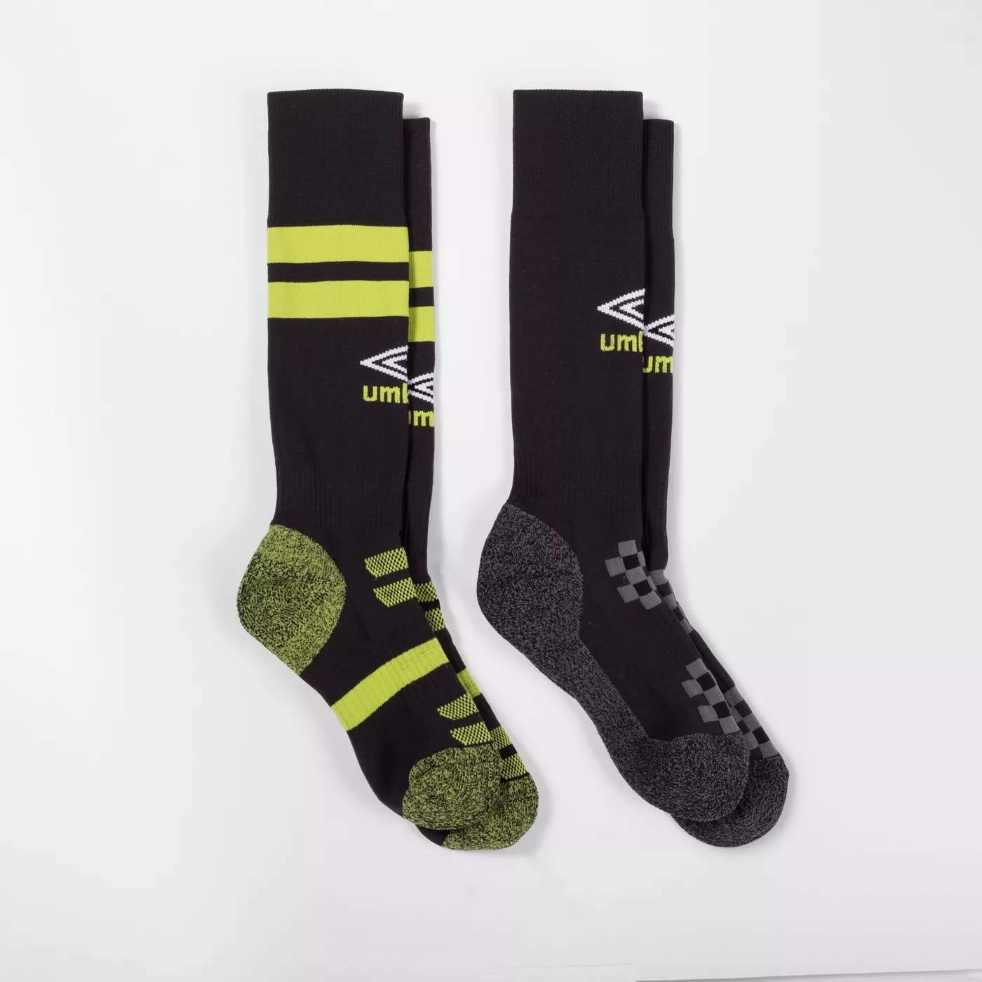 A pair of black and gray Umbro socks and a pair of black and green Umbro socks