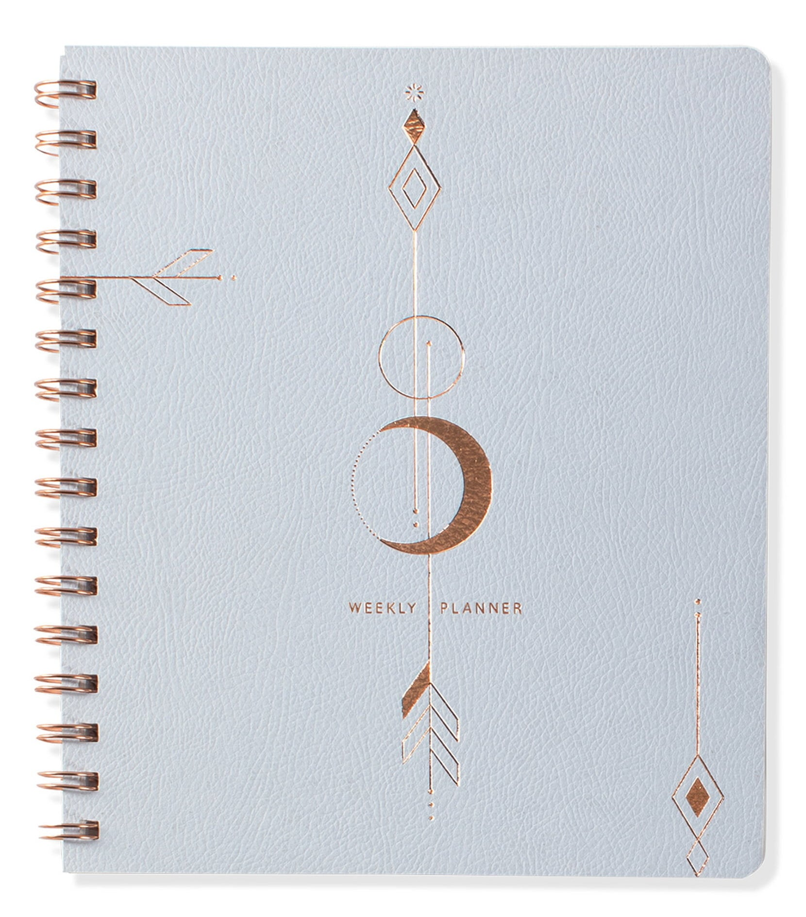 """The light blue planner with a moon arrow design and the words """"weekly planner"""" printed on it"""