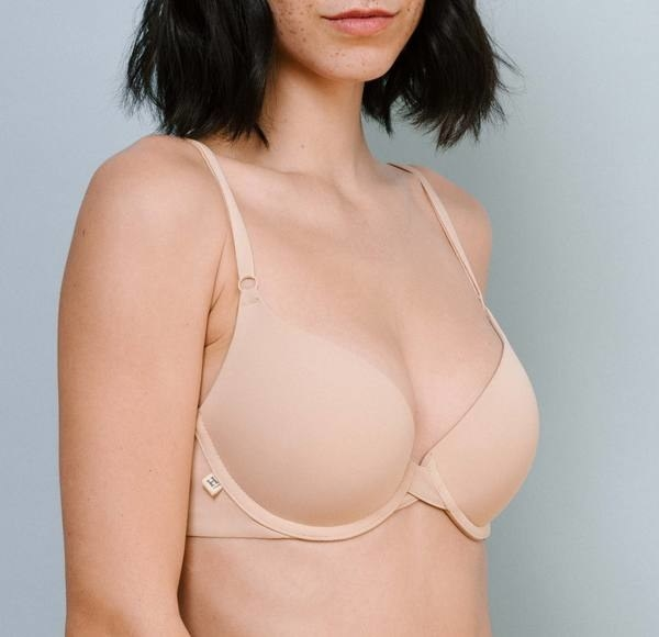 model wearing beige push-up bra