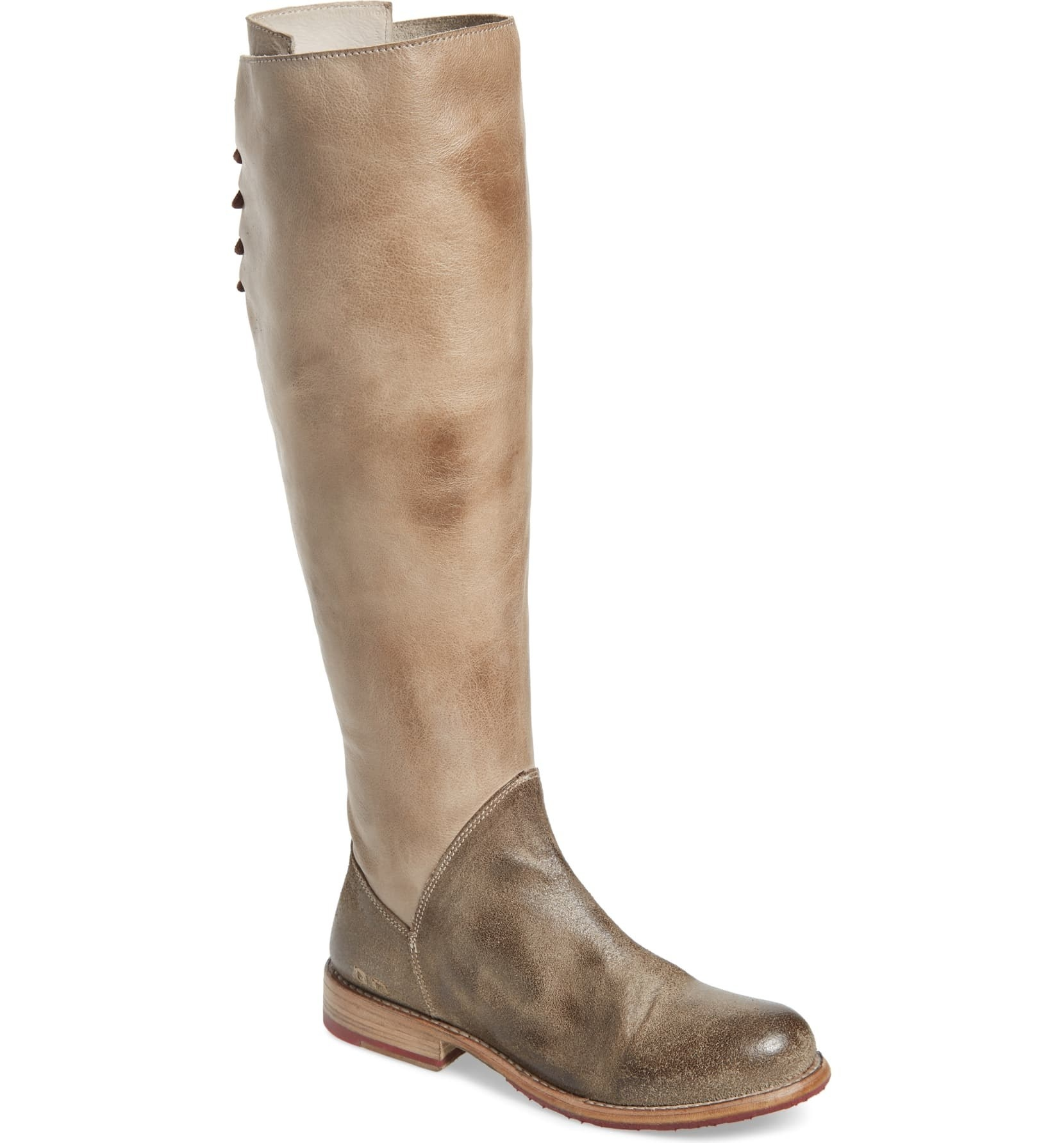 The tall boot in the taupe color, and the bottom part of the boot by the foot is a darker brown color