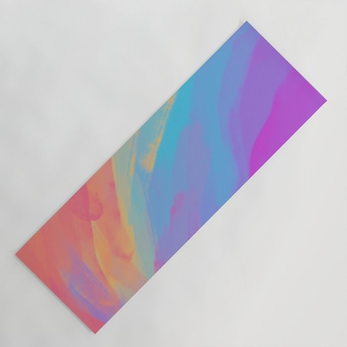 A yoga mat with watercolor-like rainbow colors all over it