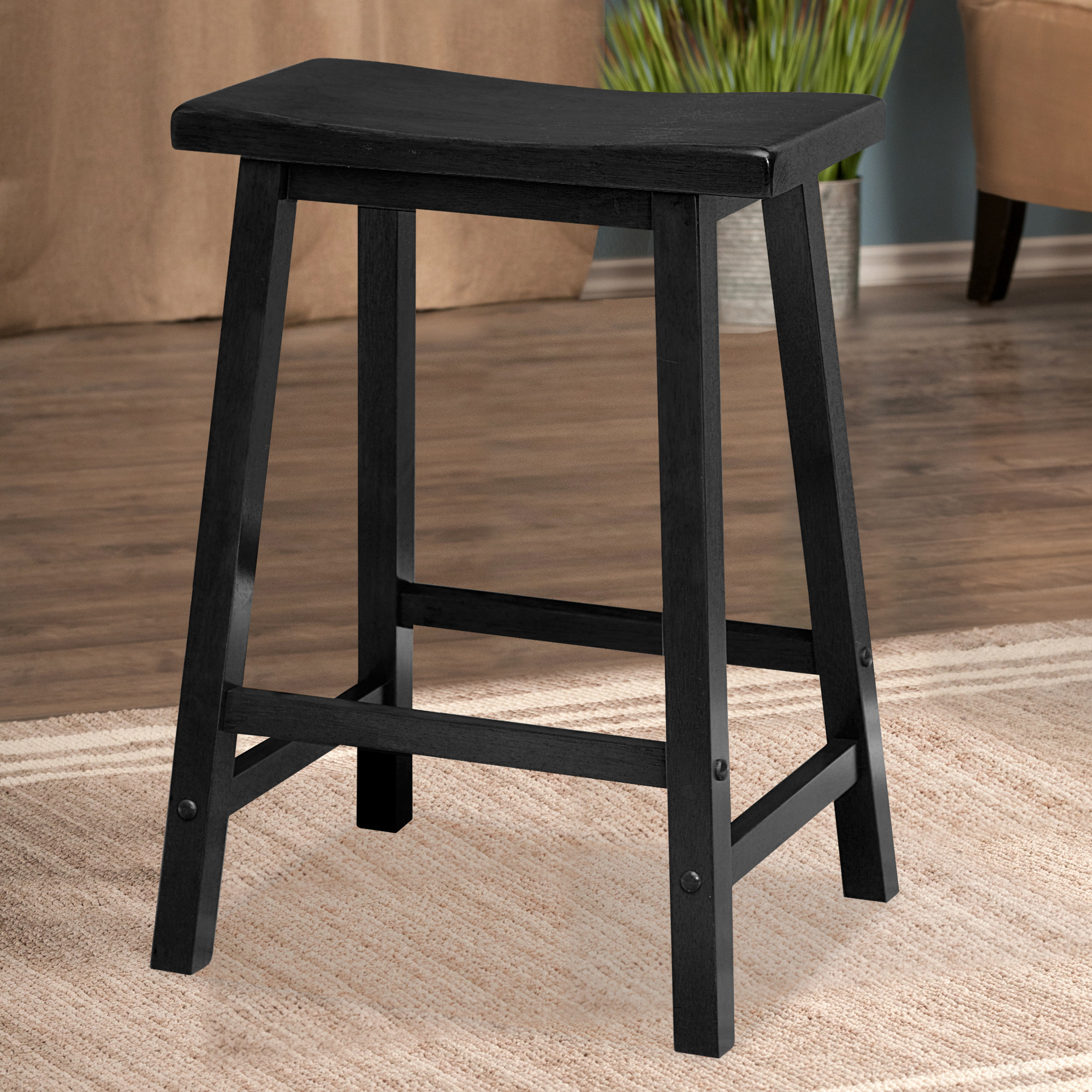 black stool in the middle of a room