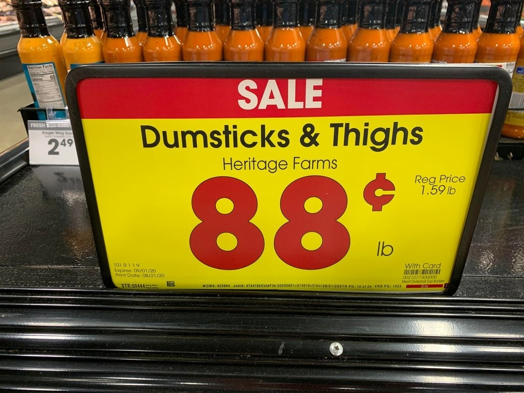 "Sign reading ""dumsticks & thighs"""
