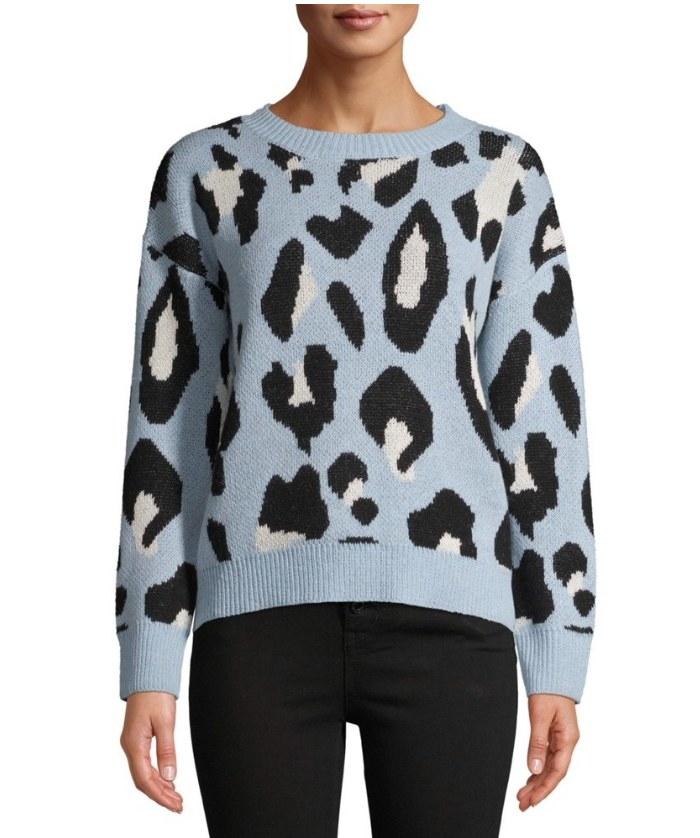 Model wearing blue leopard sweater
