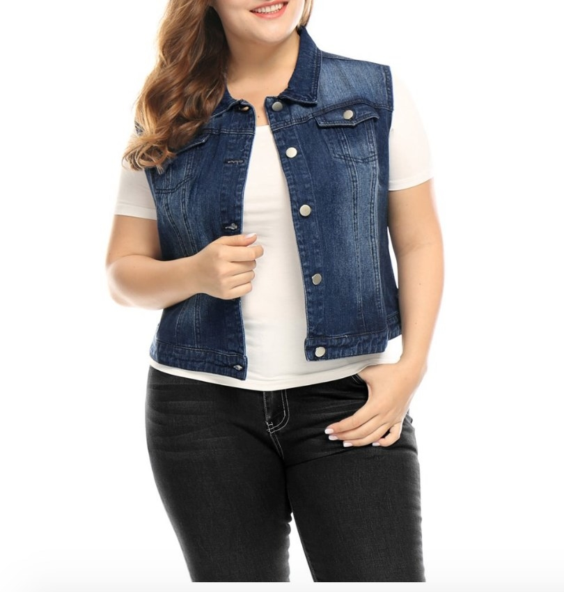 Model wearing dark denim vest over a white shirt