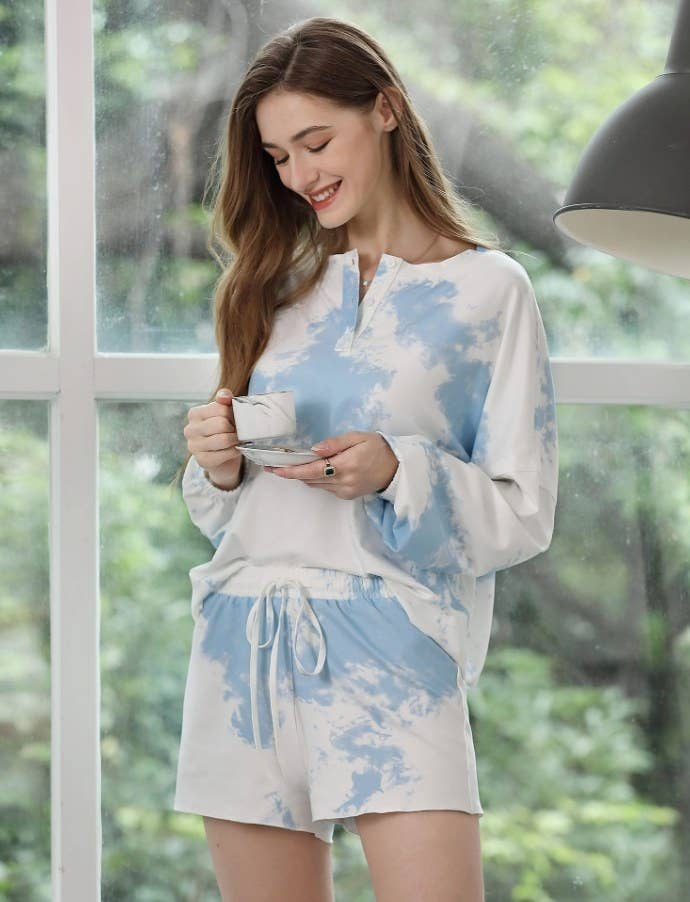 Model wearing the blue and white tie-dye set