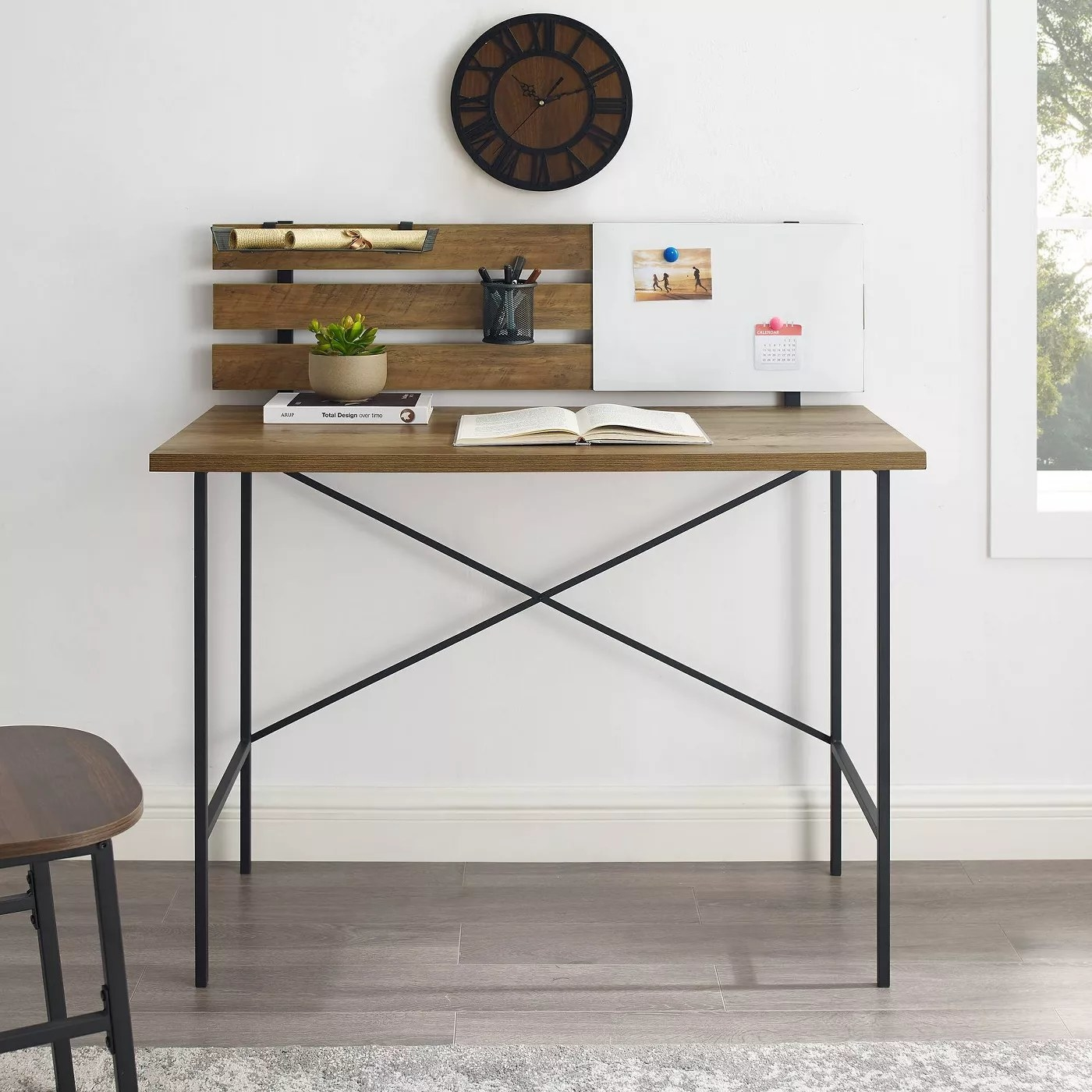 The wooden desk with a black, steel frame
