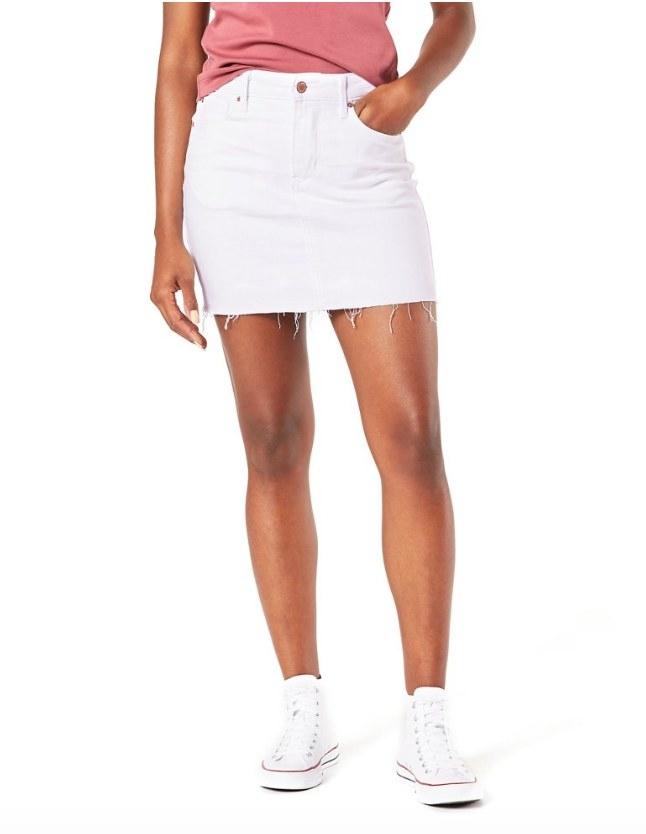 Model wearing white mini skirt