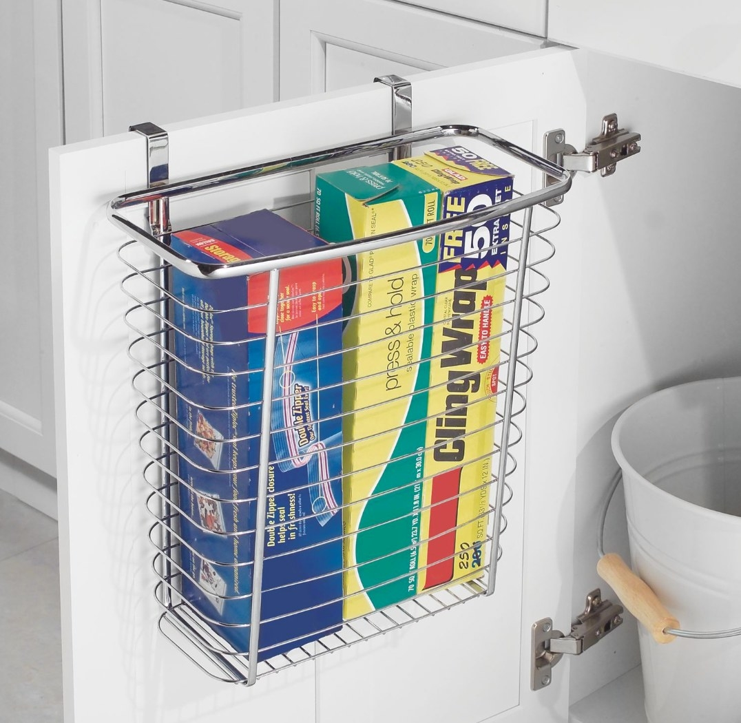 The storage basket holding cling wrap and zip lock bags