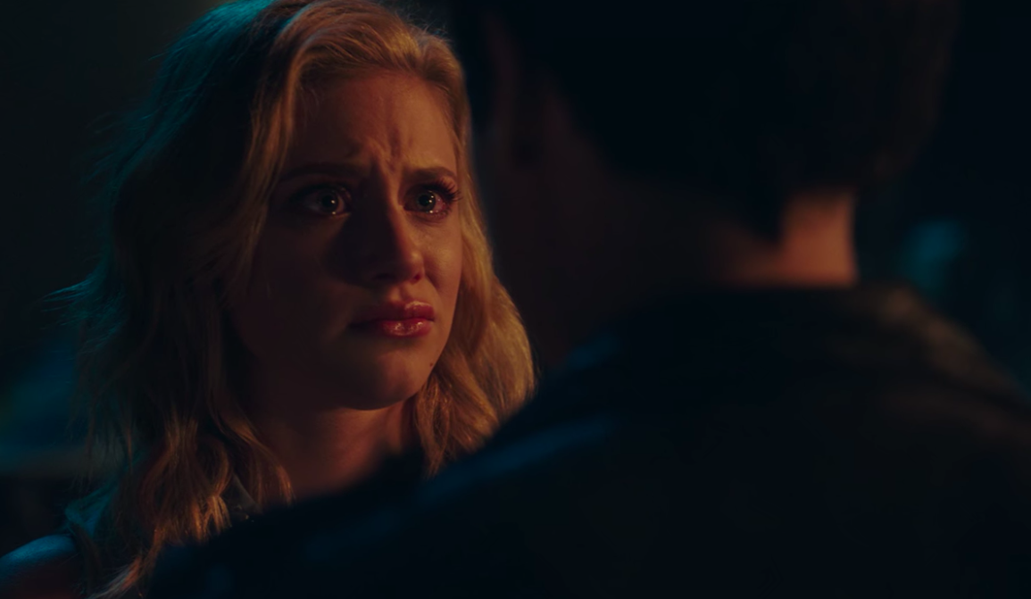 Betty cries as Jughead tells her they need to stay apart