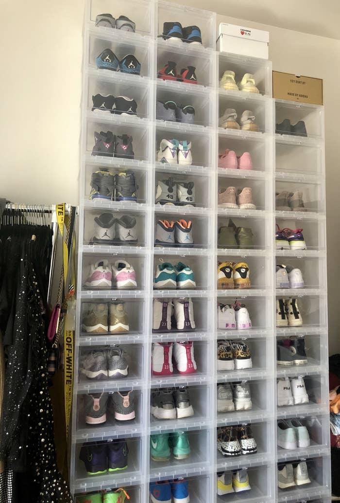 BuzzFeed editor's clear shoe boxes stacked four across and 13 high filled with sneakers in her bedroom
