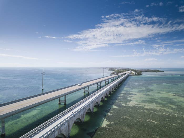 aerial view of Seven Mile Bridge over the ocean on a clear, sunny day