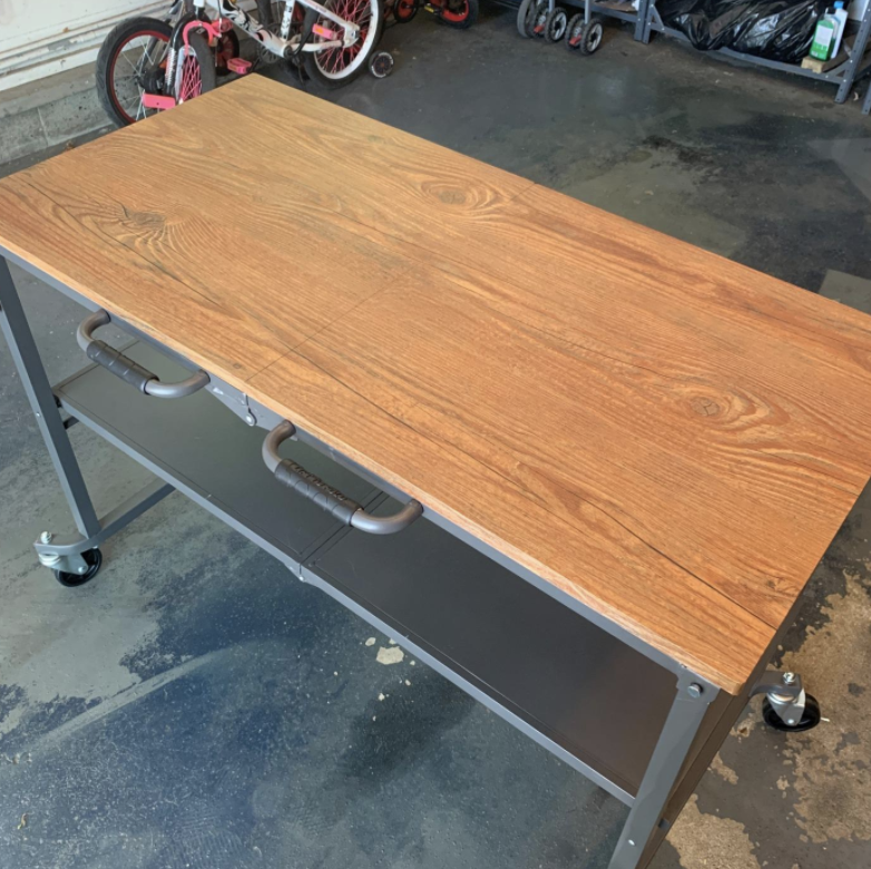 the wood top work bench on wheels
