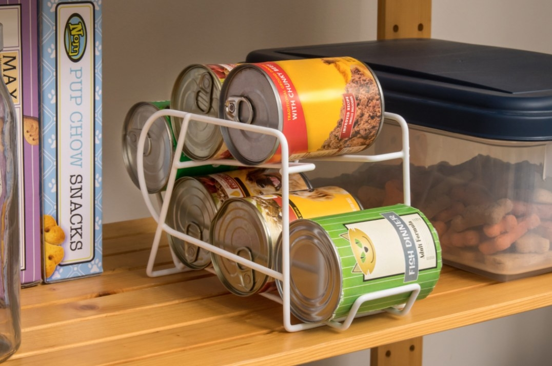 The wire rack displaying cat food cans