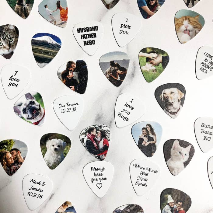 """A variety of custom picks featuring a photos of pets and loved ones on one side and messages like """"I love you"""" and """"Always here for you"""" on the other side"""