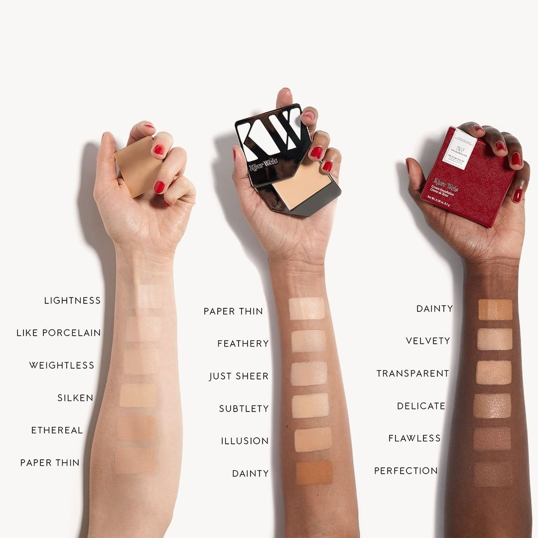 Swatches of the foundation on three arms in different skin tones