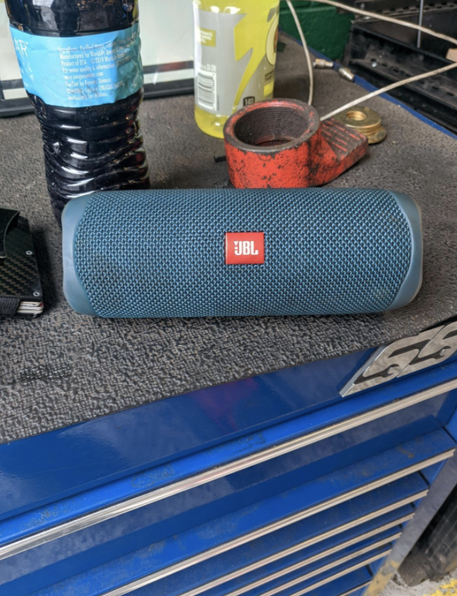 a reviewer's photo of the speaker in blue on their work bench
