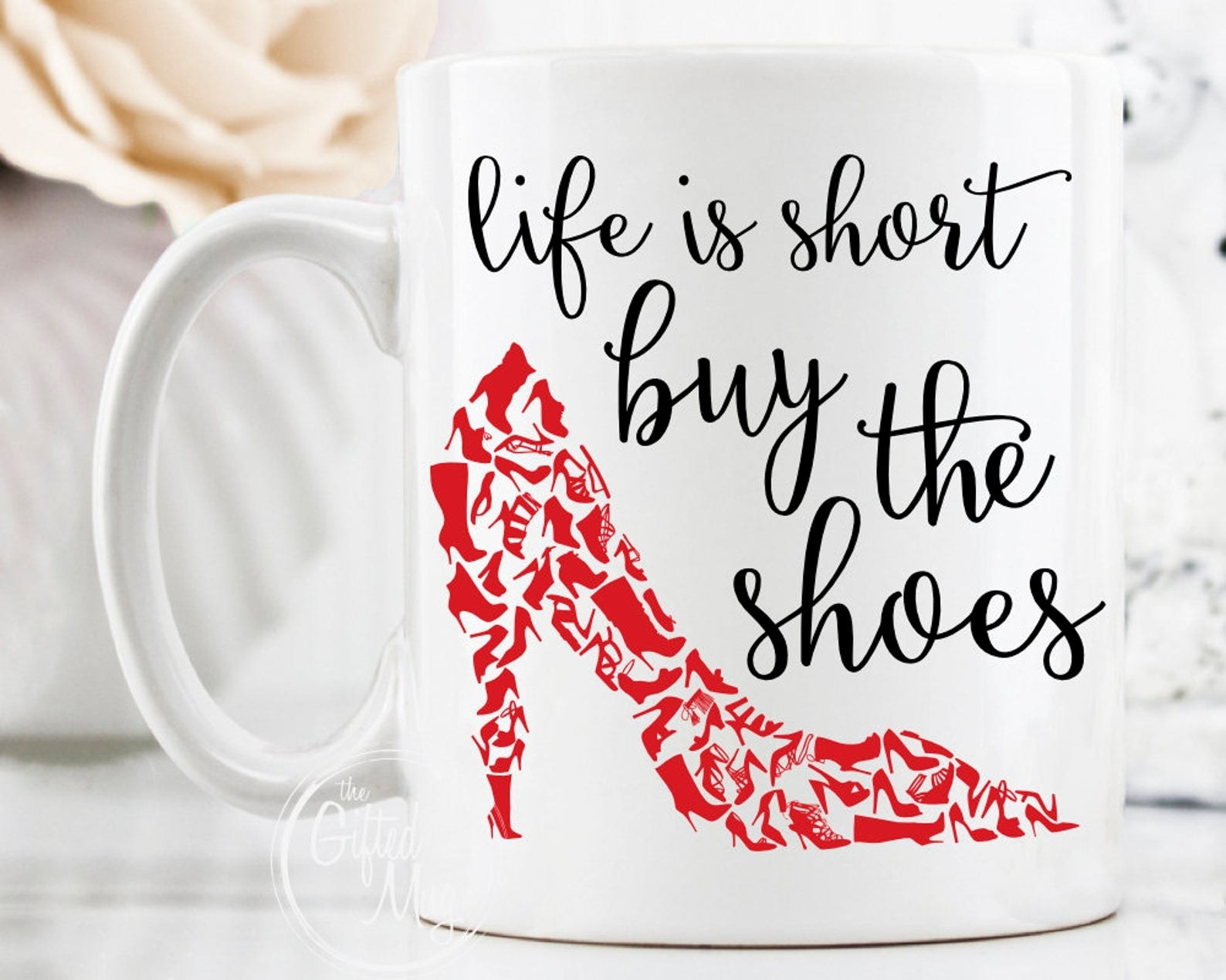 white coffee mug with a red shoe design on it and black text