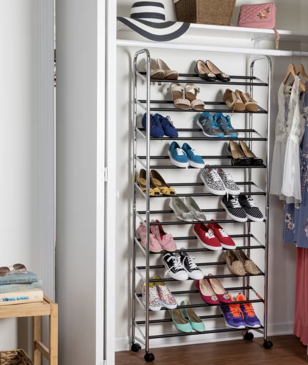 The 50 pair shoe rack inside of a close with various shoes on it, including sneakers, flats, and heels