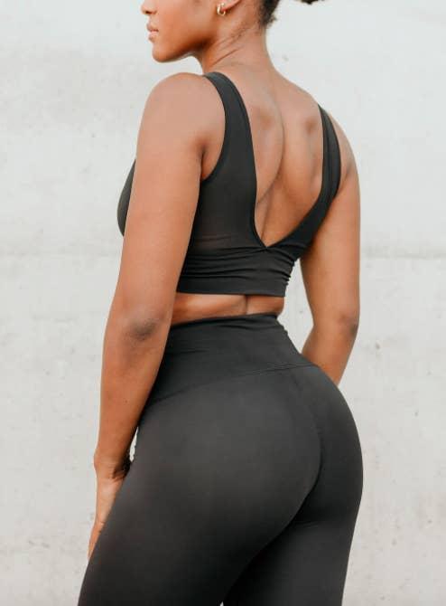 Model wears mesh black Mino Bra with matching black leggings