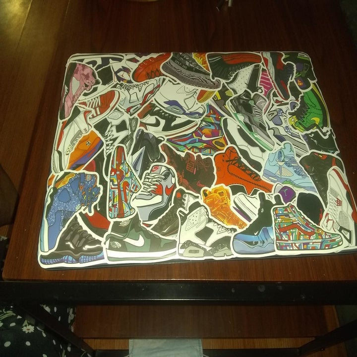 reviewer's laptop covered in sneaker stickers