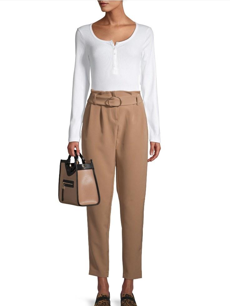 Model wearing tan pleated pants