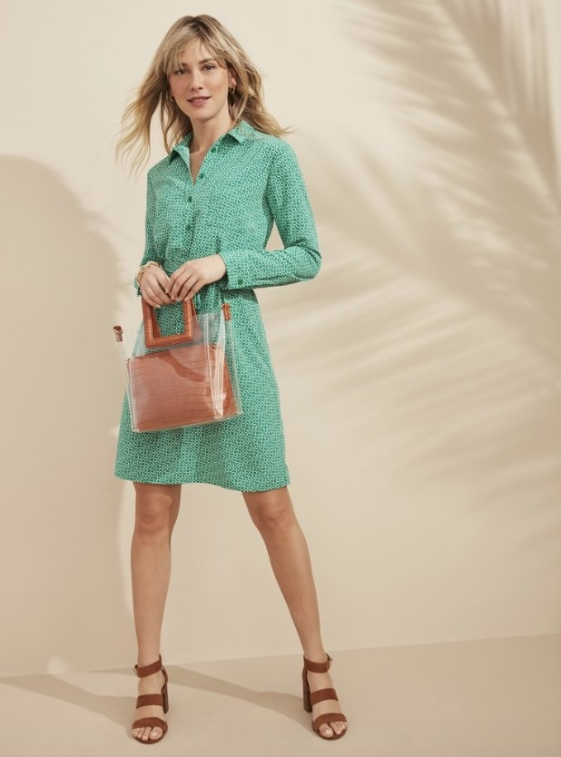 Model wearing green patterned button down above the knee dress