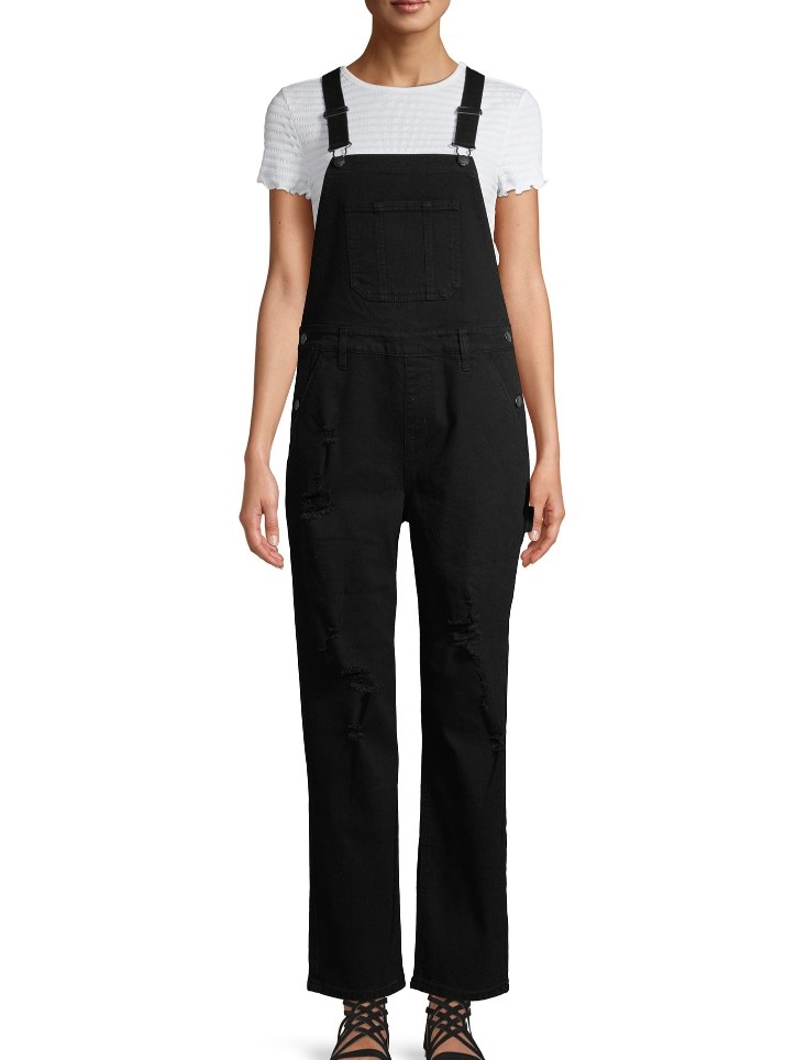 Model wearing long black denim overalls