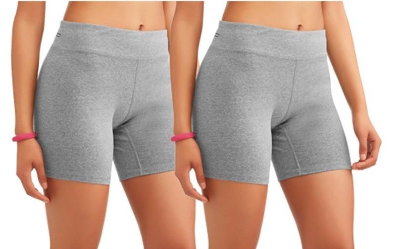 Model wearing gray thigh length shorts
