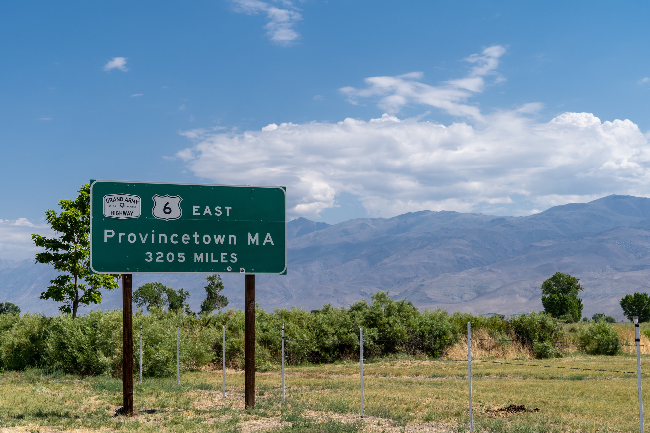 Sign for the Grand Army of the Republic Highway, noting that the end of the highway located in Provincetown Massachusetts is over 3000 miles away from Bishop California