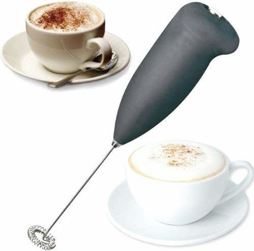 A black ZOSOE hand blender and two cups of unfrothed and frothed coffee.