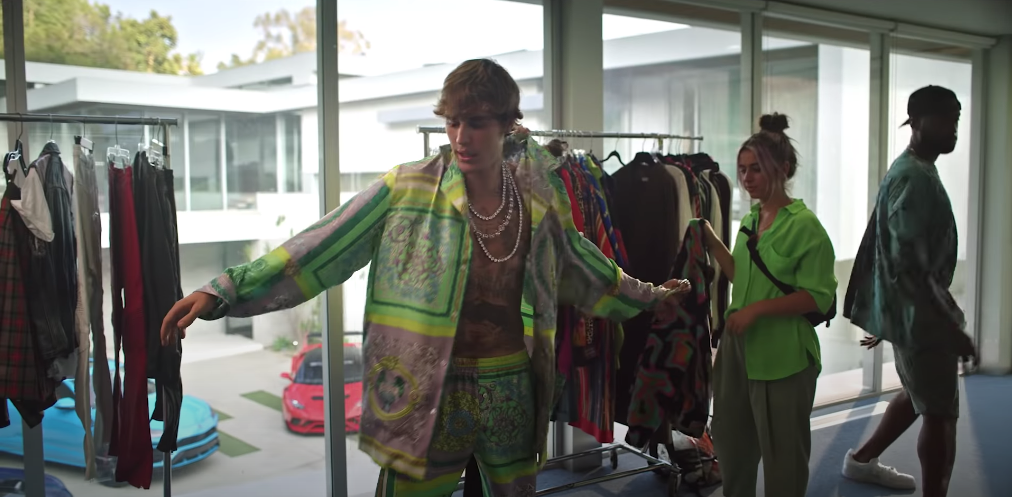 Justin gets changed into a different outfit by stylists