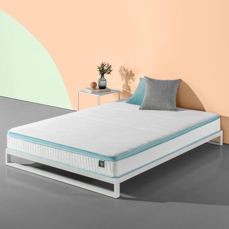 A white pillow top mattress with light blue trim