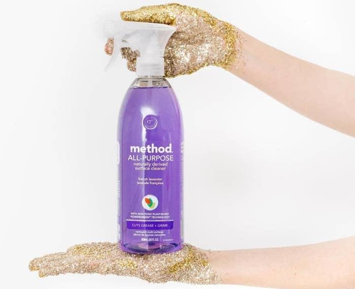Hands holding bottle of Method cleaner