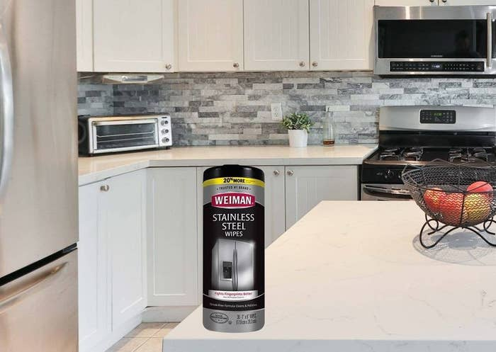 Bottle of stainless steel wipes on a kitchen counter