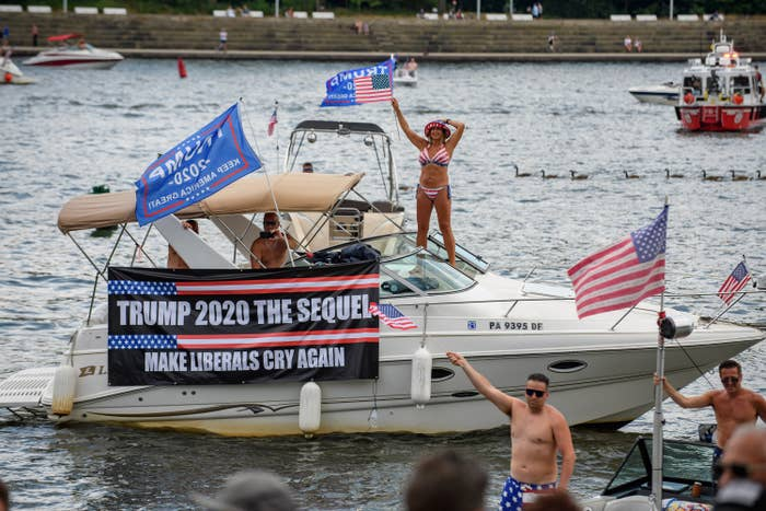"A boat with a sign saying ""Trump 2020 The Sequel, Make Liberals Cry Again"""