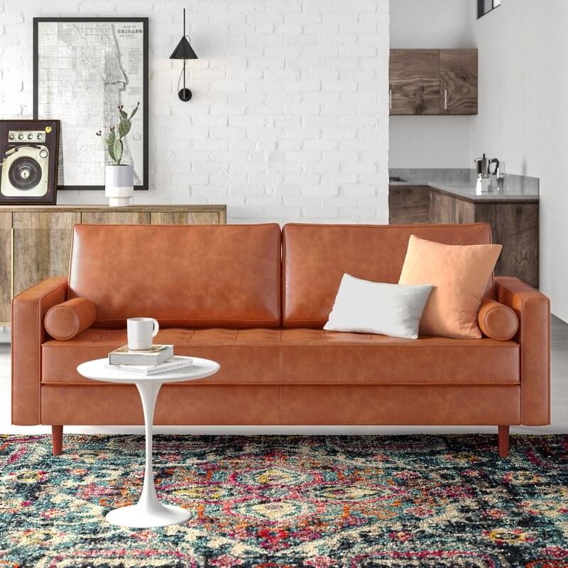 The tan leather sofa