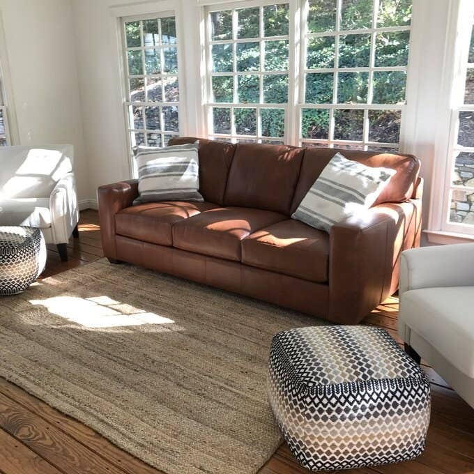 The brown genuine leather sofa