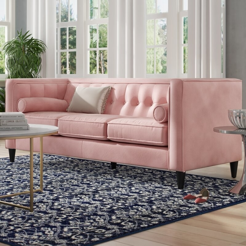 The light pink tufted sofa