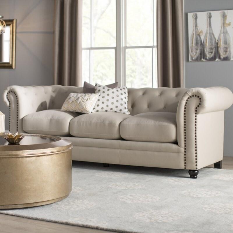 The white tufted sofa
