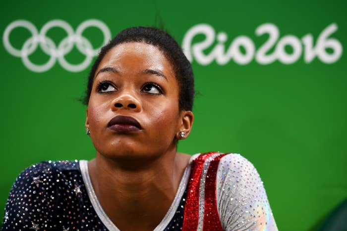 Gabby Douglas looking up towards the sky with her hair in a ponytail