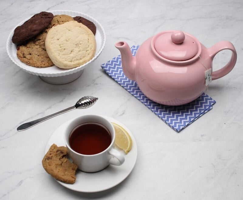 A small stoneware teapot in pink